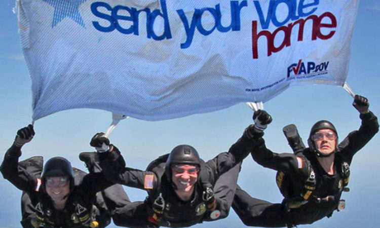 Members of the Army's Golden Knights parachute team pass on the Federal Voting Assistance Program's message