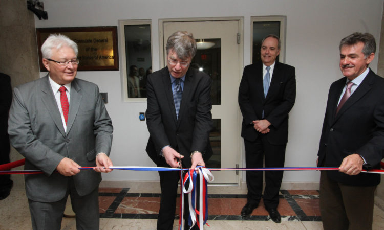 Department of State Under Secretary for Management Patrick F. Kennedy cuts the ribbon to the Consulate's new offices. He is joined by Consul General Stephen Fakan, Deputy Chief of Mission Thomas Goldberger, and Office of Building Operations Project Director Aziz Younes.