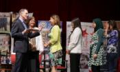 U.S. Ambassador Stephen Beecroft presenting certificates to the new graduates.